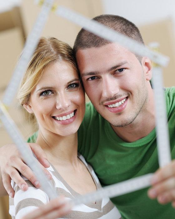 couple with house frame.jpg