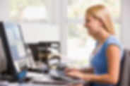 woman-in-home-office-using-computer-and-