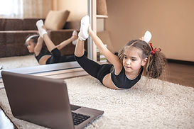 first grader doing dance lessons over zoom