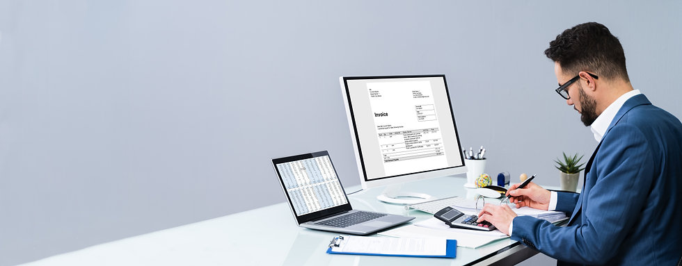Accountant Making Invoice On Computer At