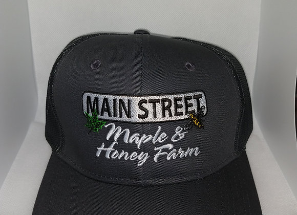 hat   trucker style with adjustable snaps  (fits most)