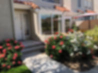 Entrance w blooming flowers.jpeg