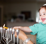 Mother and Baby Lighting a Menorah