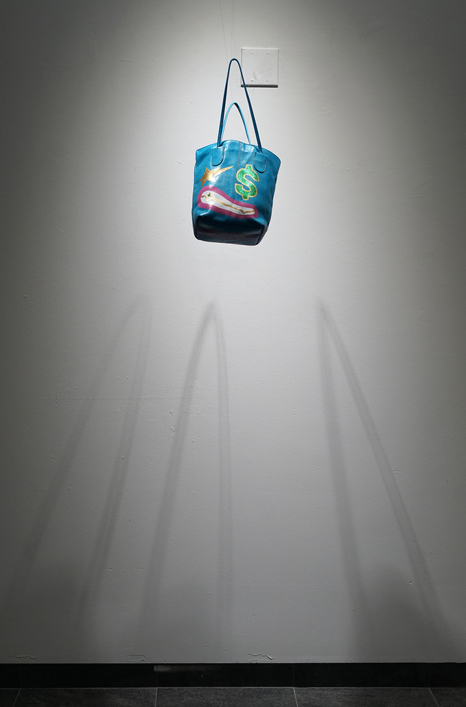 Shinin', 2019. Modified bag, suspended from the ceiling; 17.5 x 5 x 11 inches.