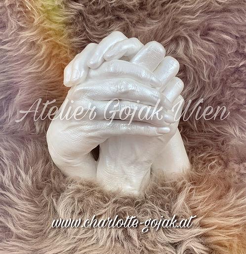 3D Abdruck Familie verschlungene Hände