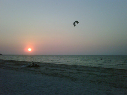 kiteboarding at the beach