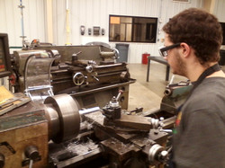 Making a drive shaft for our new robot on the lathe