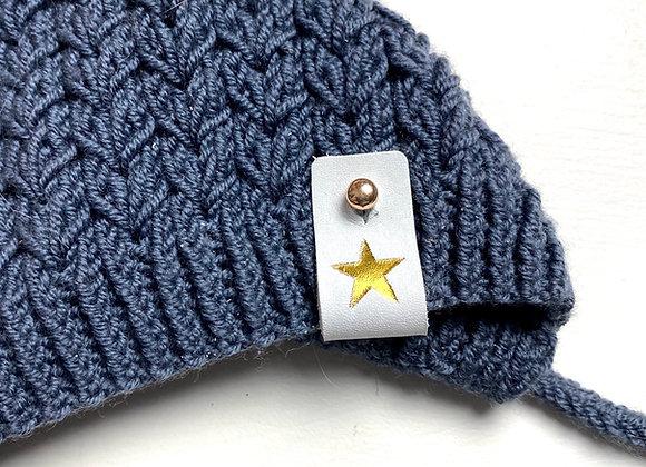 Skinnlapp i hvitt skinn med gull stjerne - avtakbar