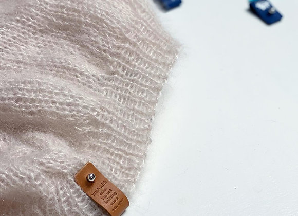 Skinnlapp med teksten: Wash with care, I'm not knitting you a new one!