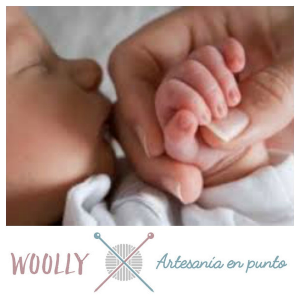 Woollyhandmade, artesanía en punto para tu bebé; canastilla
