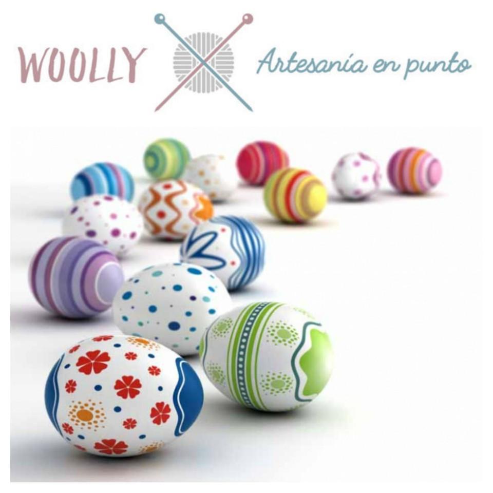 Woollyhandmade, artesanía en punto para bebé; canastilla