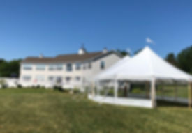 32x50 on the coast in Searsport.  rustic sailcloth tent wedding rentals maine 32x50