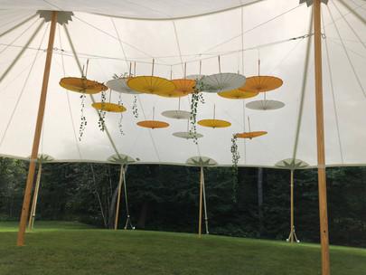 umbrellas under a sailcloth tent