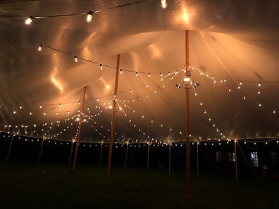 Warm LED cafe strings and up-lighting set this sailcloth tent aglow at 10 AMPs  for a 44x63.  Perfect for your maine wedding on the coast, a barn venue, backyard wedding or any event.