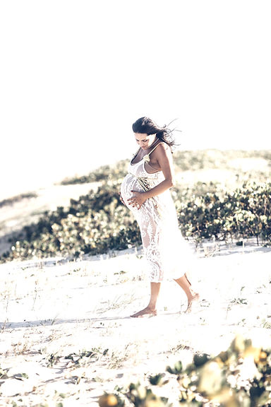 pregnant-woman-in-white-dress-walking-on