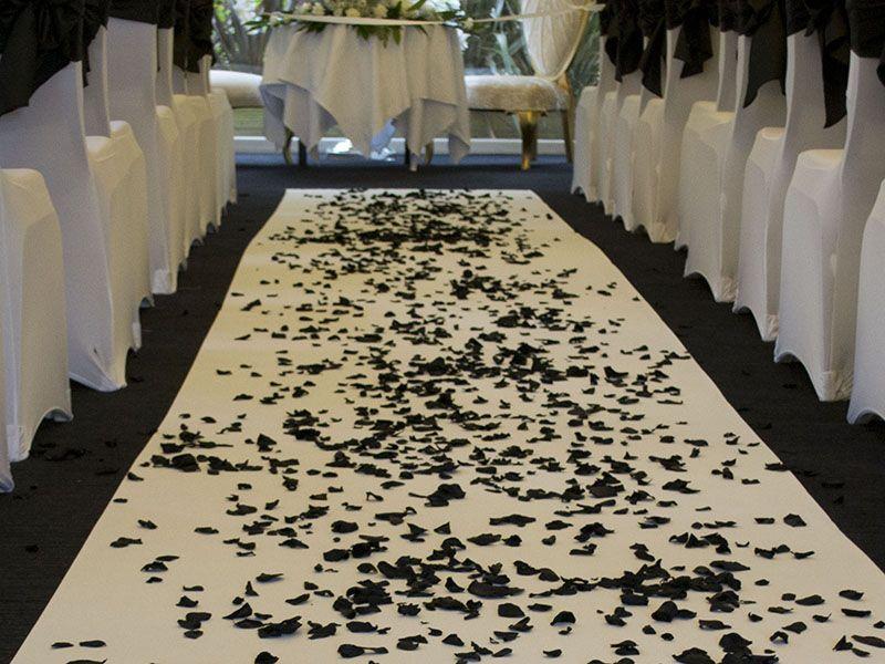 rose petal decor, decor, decor ideas, black roses, black rose petals,  wedding decor ideas, ideas for wedding decor, aisle decor, aisle decoration, aisle decoration