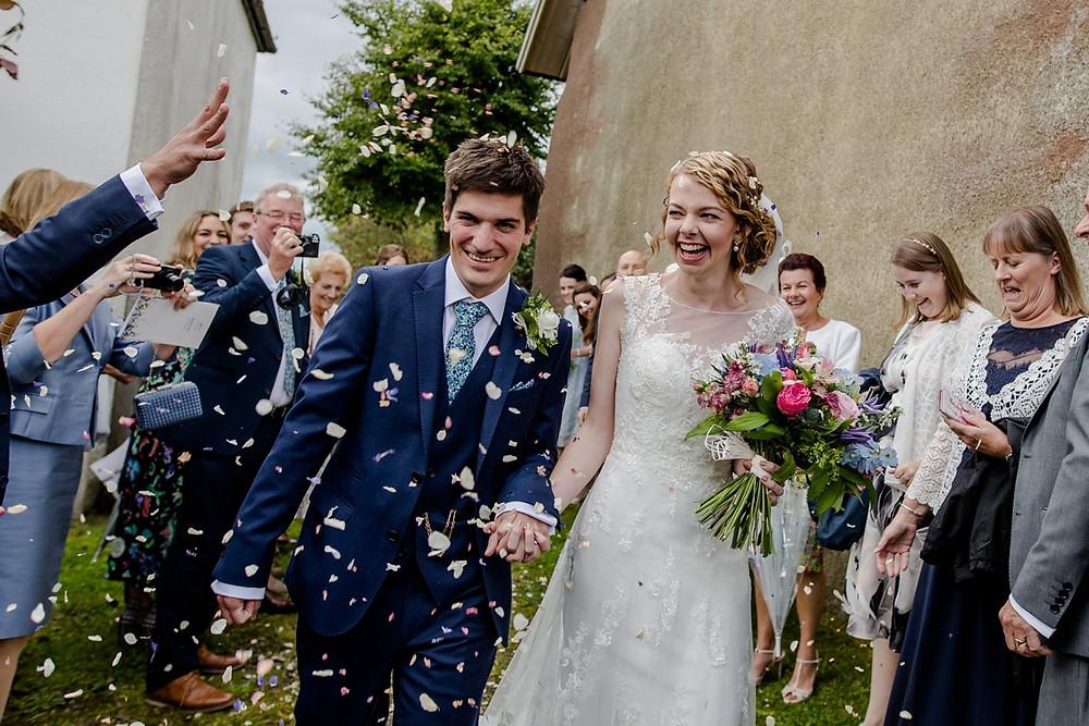 Biodegradable petal wedding confetti moment