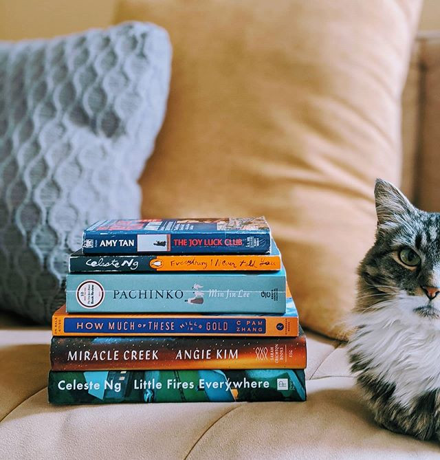 booksterjess stack of books by asian authors next to cat