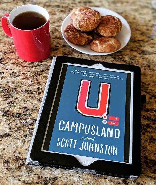 ebook next to a mug of tea and cookies