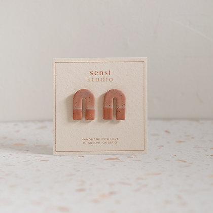 Arches in terracotta by Sensi Studio