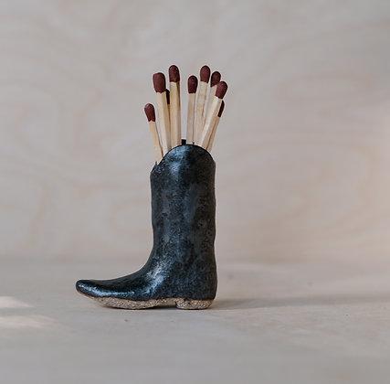 Black cowboy boot match strikers by Wallice Ceramics