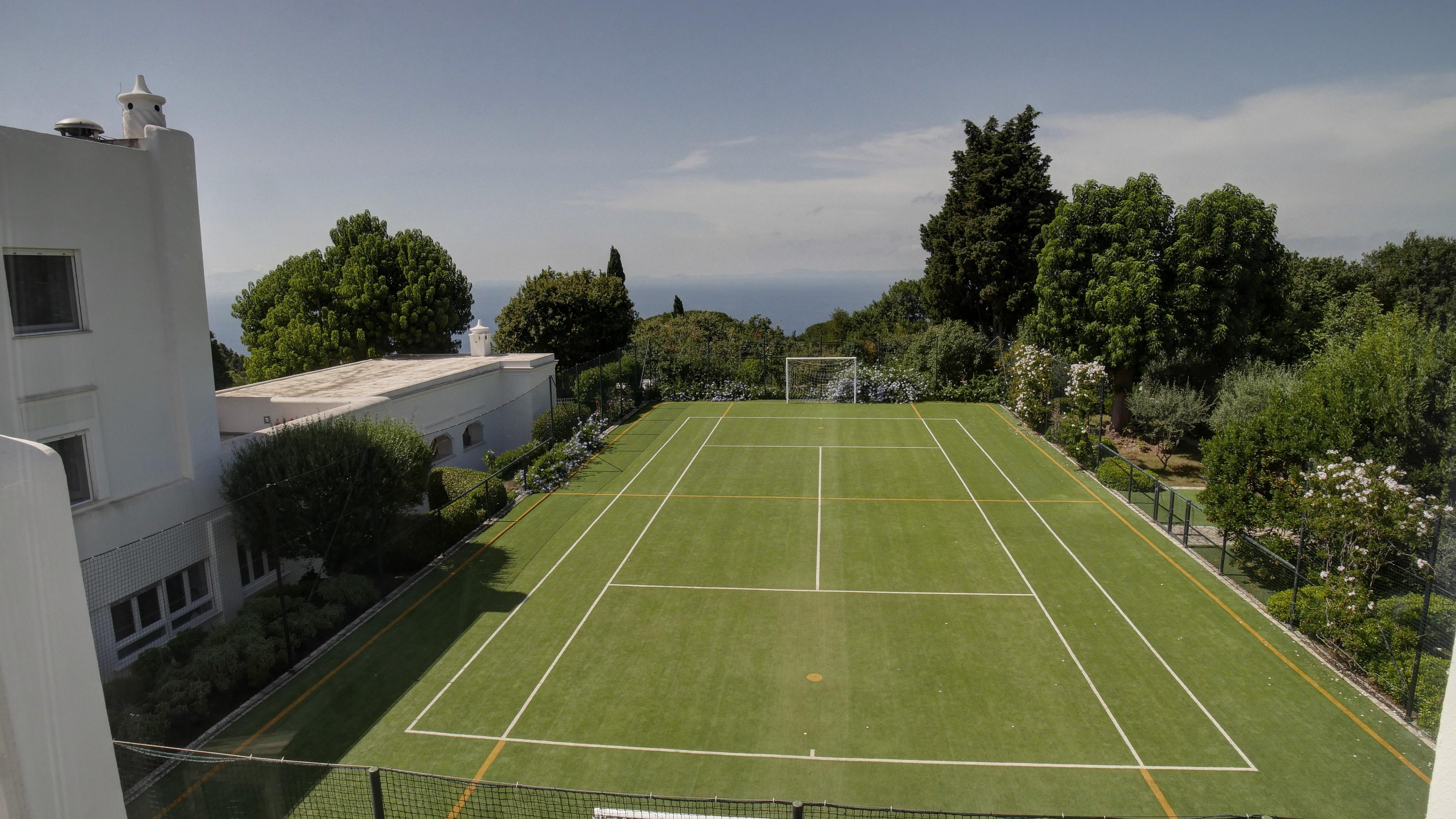 ISLAND OF CAPRI ITALY ESTATE TENNIS COURT ENCAPSULATED IN GREEN ARBOR