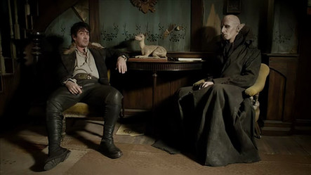 Deacon And Petyr Seated