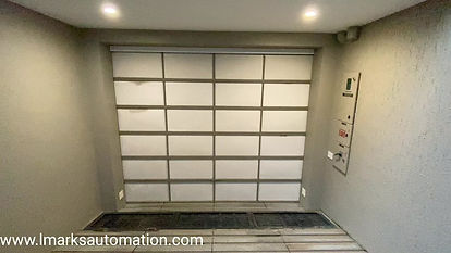 LMARKS AUTOMATION | TOP ROLLING AUTOMATIC GARAGE DOOR