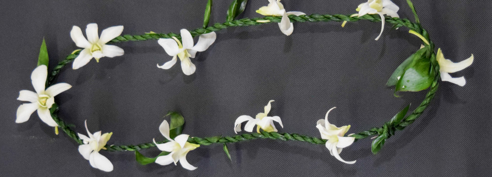 Single strand ti leaf with dendrobium orchids tucks