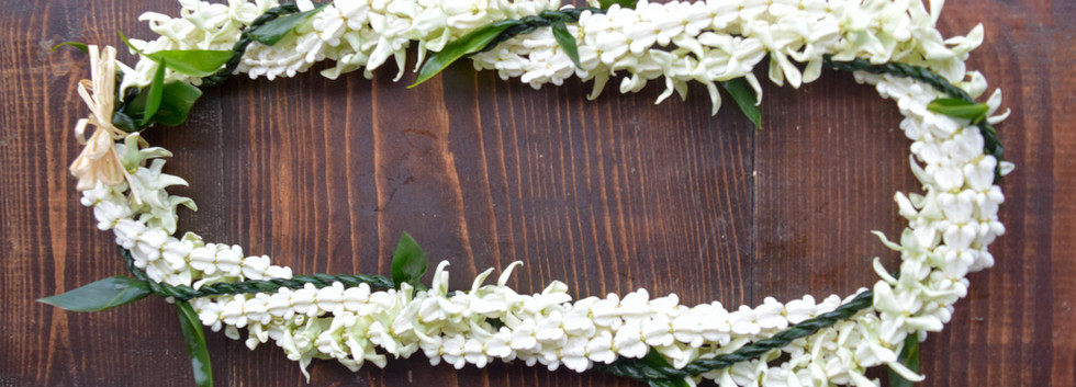 Quadruple strand ti leaf and crown flower twist lei
