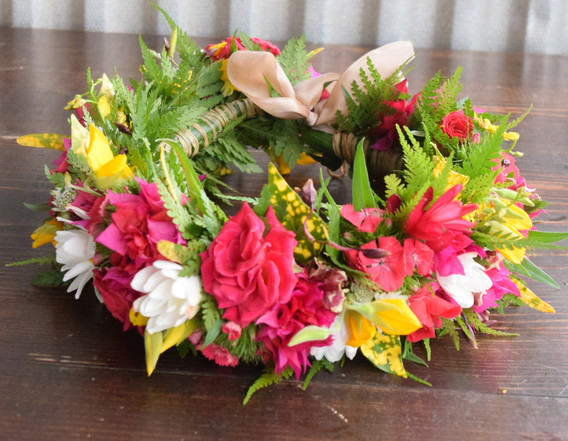 Bright pinks, yellows and pops of white lei po'o