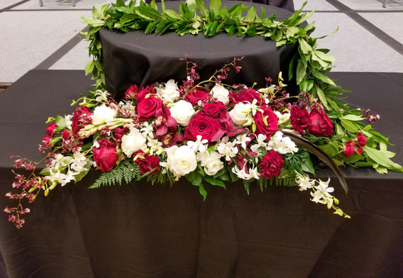 Long arrangement and a maile lei
