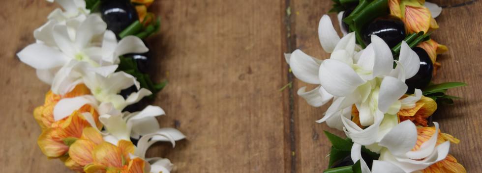 Triple twist orchid, ilima and kukui nut lei
