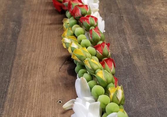 Quadruple twist rosebuds, seagrapes and tuberose