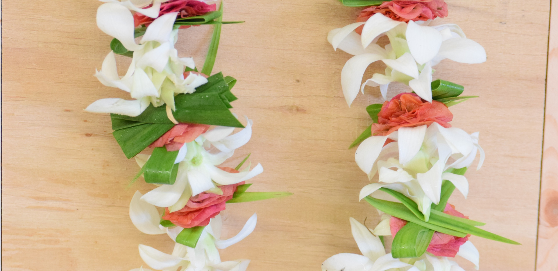 Orchid, bougainvillea and bamboo orchid foliage lei