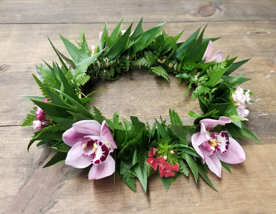 Mostly foliage wi th tucks of flowers - flower crown