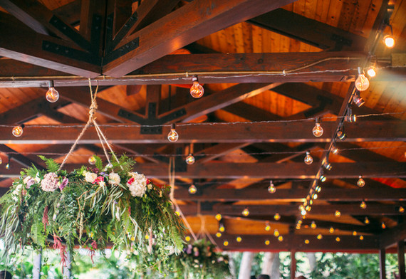 Hanging chandeliers of foliage with flowers
