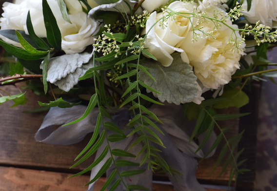 white bouquet with a silver bow