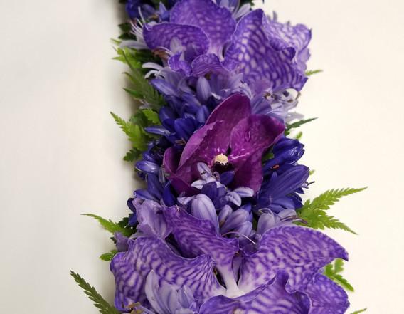 Purple and blue lei po'o
