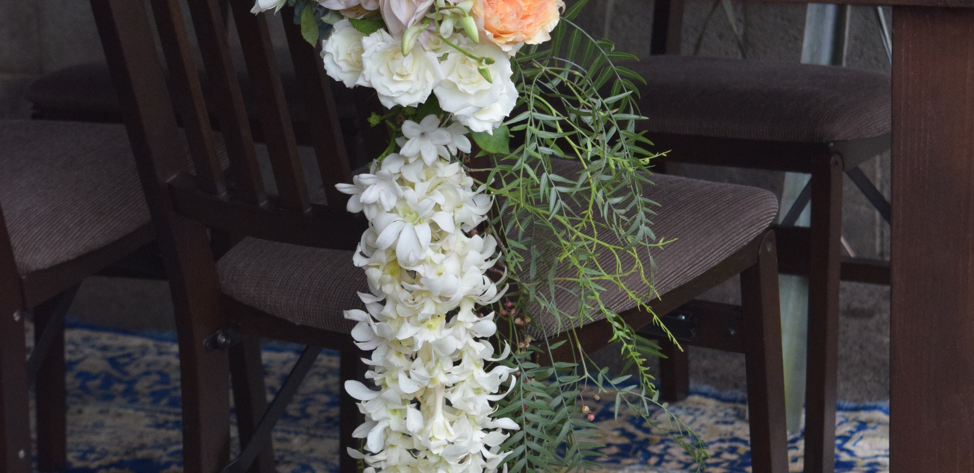 Chair decor with hanging strands