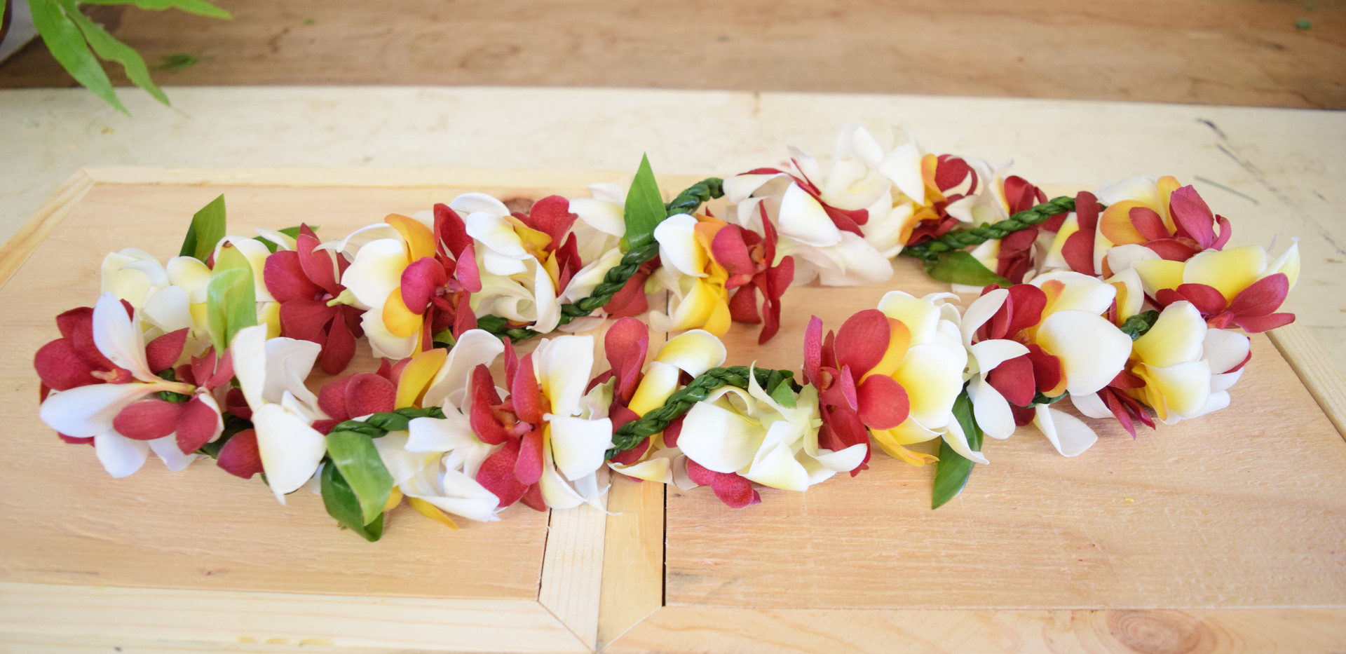 Double orchid, plumeria and ti leaf lei