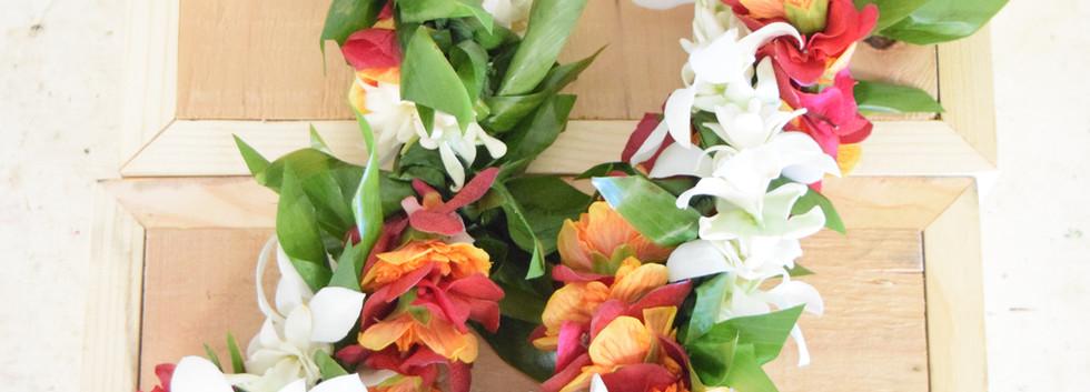 Triple twist orchid, ilima, bougainvillea and ti leaf