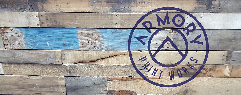 Armory Print Works - wood wall with logo