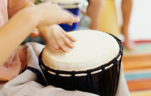 close-up of a djembe drum being played