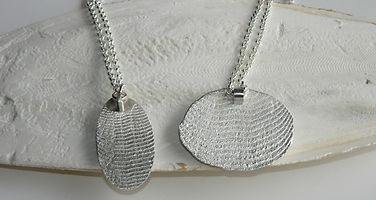 Cuttlebone cast sterling silver pendants