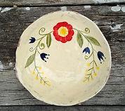 Hand decorated ceramic plate.jpg