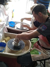 Trying the potters wheel