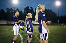 Girls Standing on Soccer Field