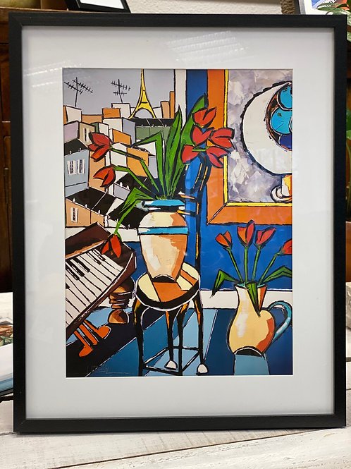 The old piano with two vases of tulips with blue oranges