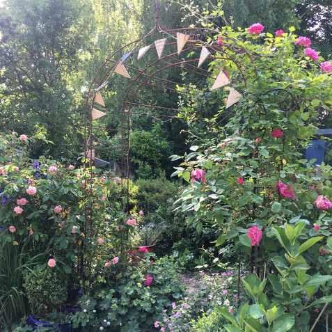 An archway adds interest to the cottage garden
